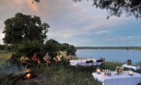 Relaxing on a canoe safari on the Zambezi River, upstream from the Victoria Falls, Zimbabwe
