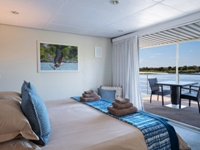 Inside a Chobe Princess room, on the Chobe River in Namibia. Chobe, Victoria Falls, Hwange safari.