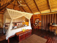 Thatched chalet at Nehimba Lodge - Hwange National Park, Zimbabwe