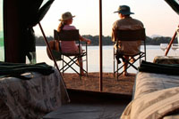 Multi-day Canoe safari along the Zambezi River, camping along the river in Mana Pools, Zimbabwe