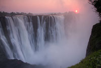 Beautiful sunrise over the spectacular Victoria Falls, seen from Zimbabwe