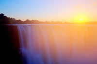 Magical Victoria Falls - Main Falls at sunrise from the Zimbabwe side of the Zambezi River
