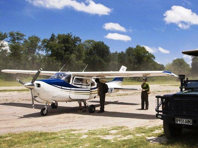 Light aircaft on landing strip
