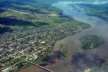 The Zambezi River passing the town of Tete in central Mozambique. Mozambique will overcome a shipping