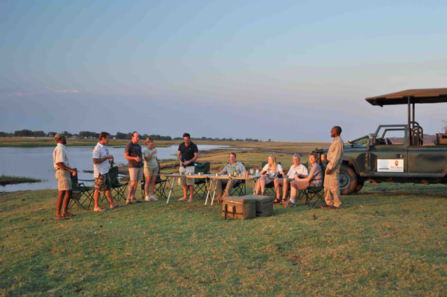 Sundowners on the game drive by the Chobe River - Chobe National Park, Botswana