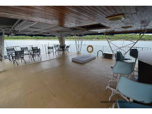 Large under cover aft deck with 2 tables and chairs, Bar, Large fridge/Bottle cooler.