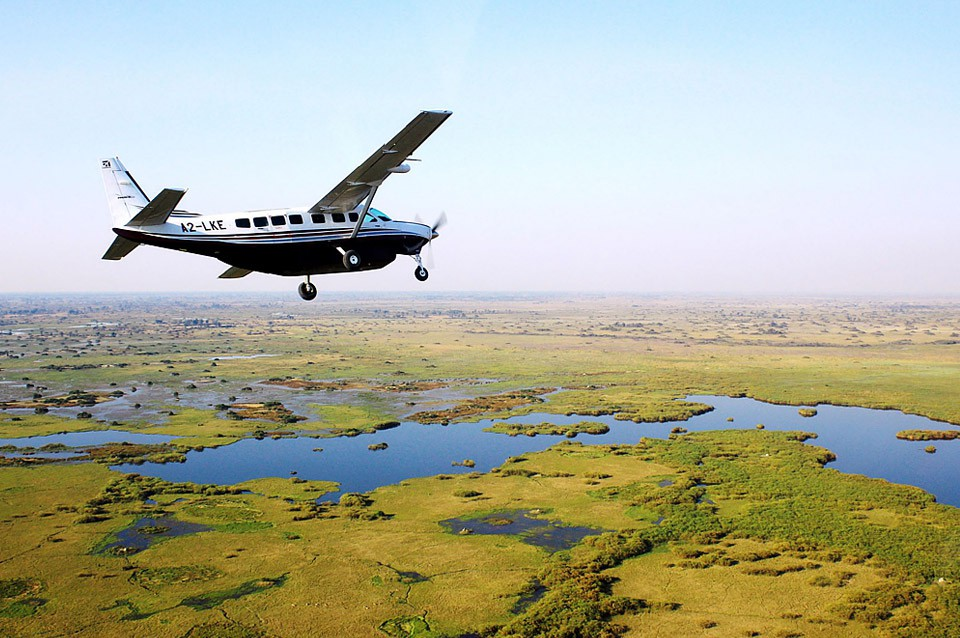 Flying into the Okavango Delta (Botswana) in a charter plane is the best way to get to the private camps especially