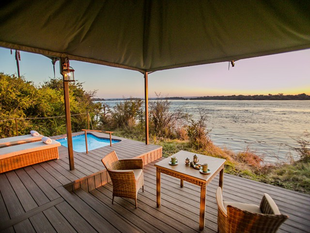 Opulent safari living at Old Drift lodge within the Zambezi National Park, on the banks of the mighty Zambezi River in Zimbabwe, just 10kms upstream from the famous Victoria Falls