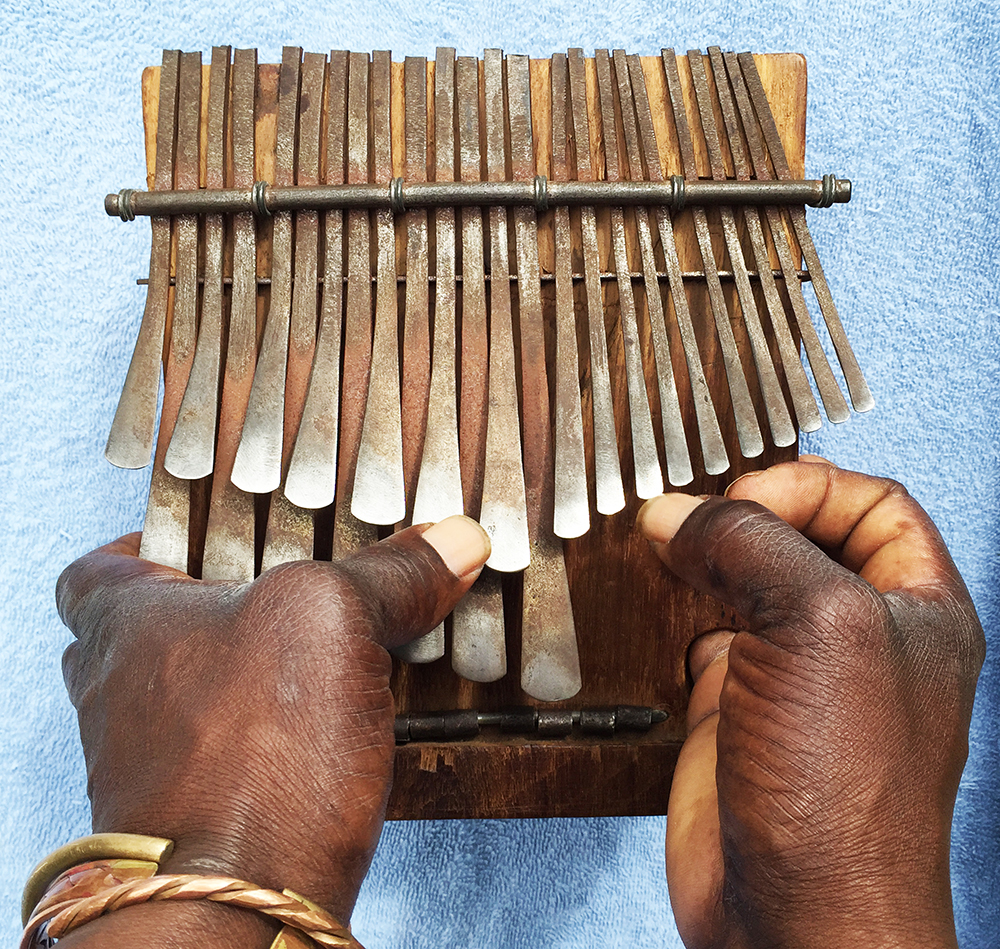 Person playing the mbira or hand piano