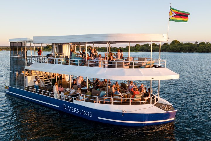 Riversong boat on the Zambezi River. Luxury cruise boat for sunrise, lunch and sunset cruises - Victoria Falls, Zimbabwe