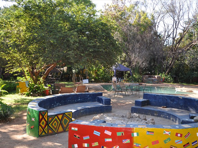 The fire pit and swimming pool in the background