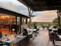 Dine in the cool shade with a view of the bush