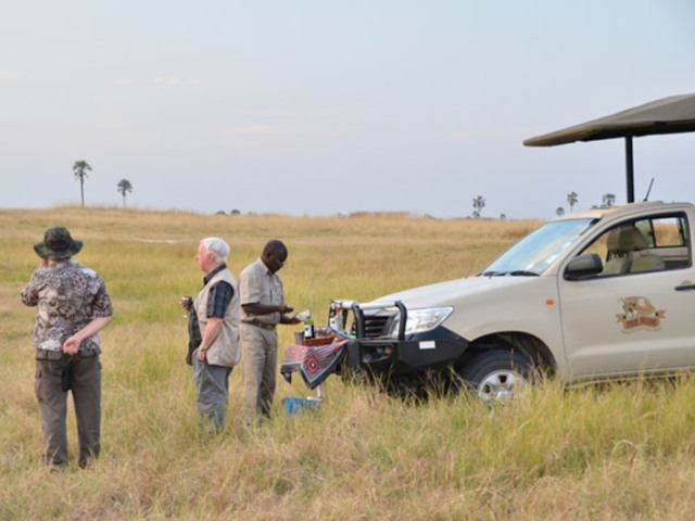 Sundowners on the afternoon game drive at The Hide in Hwange National Park, Zimbabwe