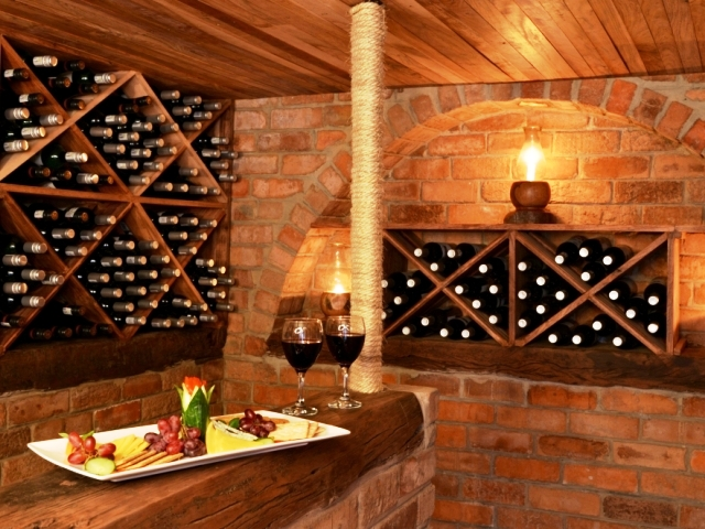 The wine cellar in the underground hide at The Hide in Hwange National Park, Zimbabwe