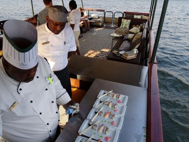 Victoria Falls Hotel chefs prepare sushi on The Victoria, Zambezi River cruise, Victoria Falls, Zimbabwe