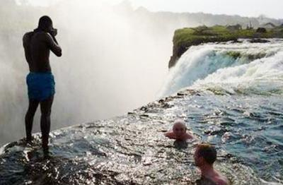 Tourist gambling with death on the edge of the Victoria Falls