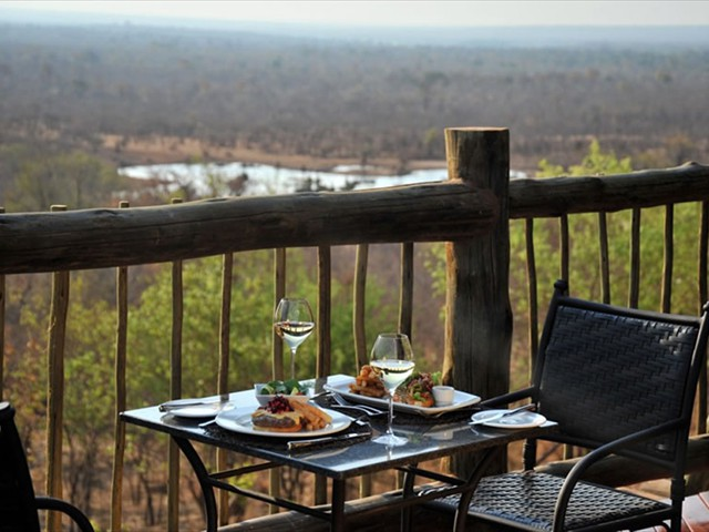 Lunch overlooking the Vic Falls Safari Lodge waterhole and Zambezi Naitional Park