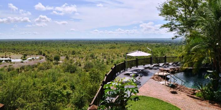 The deck at Victoria Falls Safari Lodge facing the national park and an active waterhole - Victoria Falls, Zimbabwe