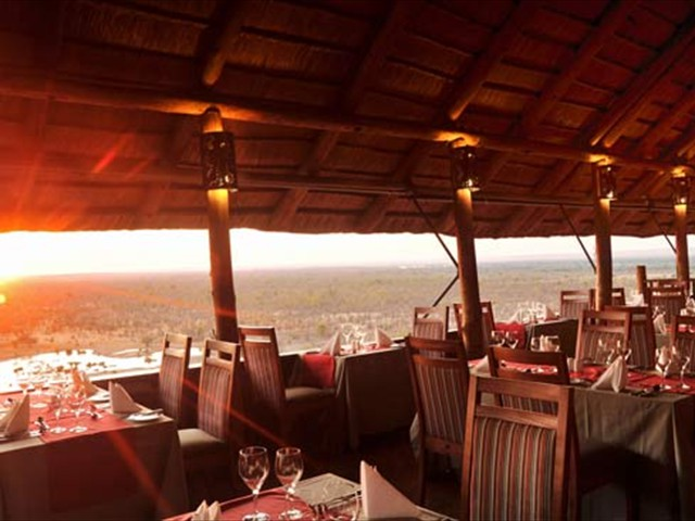 Open dining at Makuwa-kuwa Restaurant, with a view of the national park in Victoria Falls, Zimbabwe