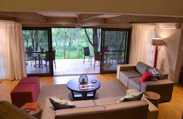 Victoria Falls Safari Suites living room and veranda, Victoria Falls, Zimbabwe