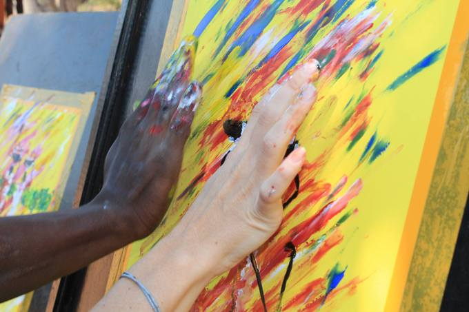 Finger painting on an Art of Africa cultural tour in Victoria Falls