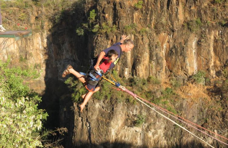 Family adventure on a tandem gorge swing in Victoria Falls, Zimbabwe
