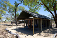 In front of a room at Davisons Camp - Hwange National Park, Zimbabwe