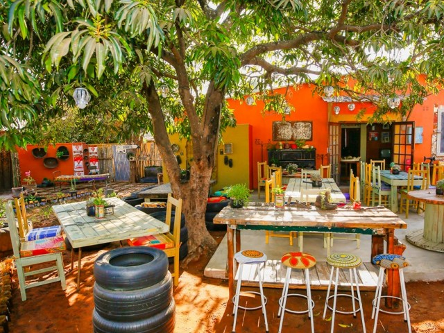 Bright coloured township restaurant in Victoria Falls, Zimbabwe - Dusty Road