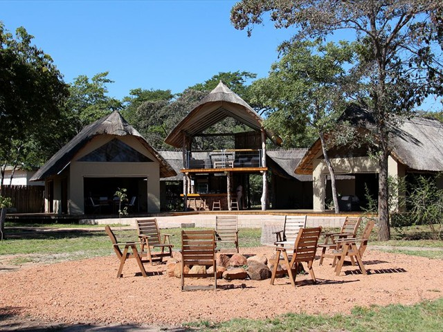 The fire pit and view of the deck and main lodge