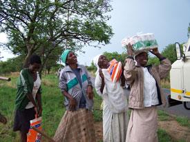 Handing Food To Zimbabwe People