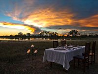 Dinner by the pan at Bomani Tented Lodge in Hwange National Park, Zimbabwe