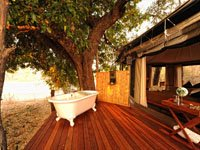 Deck and outdoor bath at Kanga Camp in Mana Pool, Zimbabwe