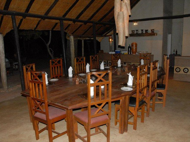 Meals are served under the thatched dining area