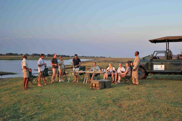 Sundowners on a game drive in Chobe, Botswana