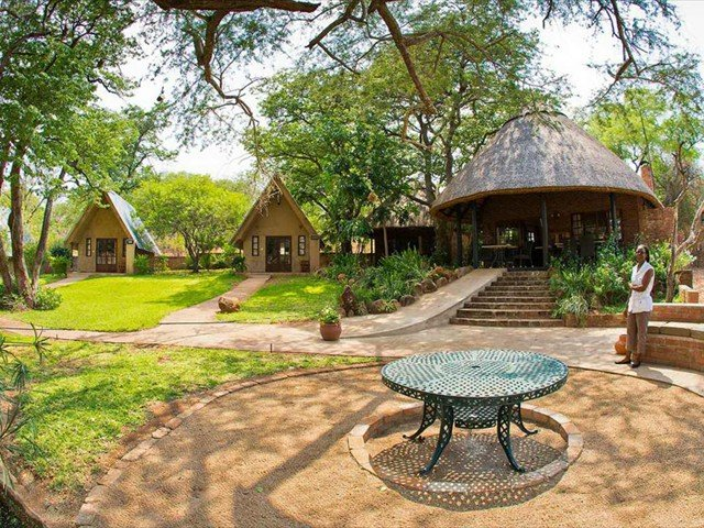 The firepit, chalets and main lodge