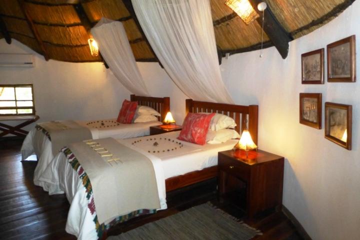 A twin room at Waterberry Zambezi Lodge