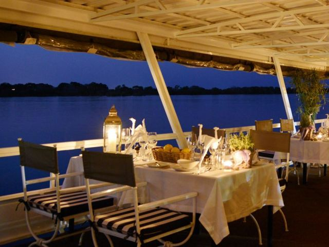 Tables are set for dinner on the Zambezi Reflections in Victoria Falls, Zimbabwe
