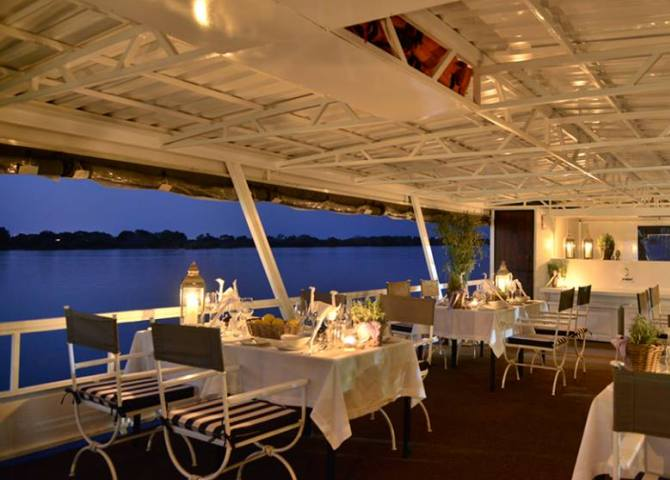 The table setting on the Zambezi Reflections boat for the dinner cruise on the Zambezi River from Victoria Falls, Zimbabwe