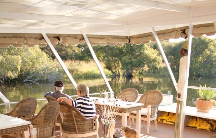 Enjoying the scenery on the Zambzi Royal on Zambezi River - Victoria Falls, Zimbabwe