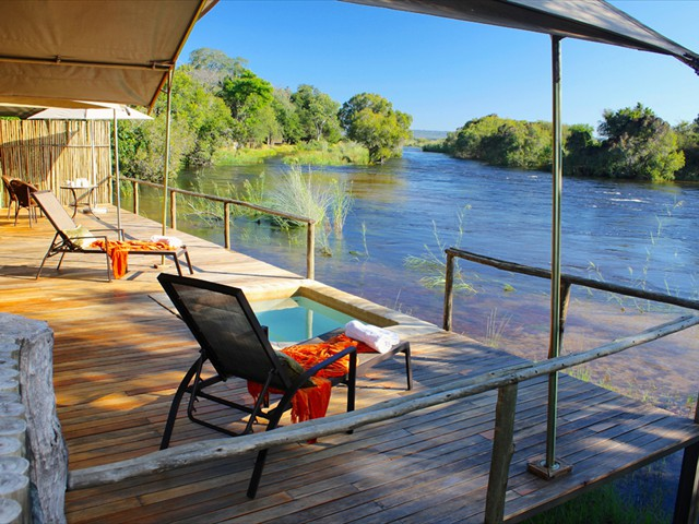 Rooms have their own private decks facing the river